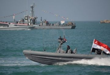 12256610-alexandria-egypt-nov-25-2011-the-egyptian-navy-commemorating-the-january-25th-revolution-while-dem