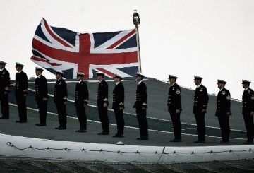 PORTSMOUTH, UNITED KINGDOM - JUNE 28:  Sailors on board the aircraft carrier HMS Illustrious wait  on the flight deck to salute during The International Fleet Review on June 28, 2005  in Portsmouth, England. The Review forms part of the Trafalgar 200 celebrations marking the 200th anniversary of the Battle of Trafalgar at which Lord Nelson commanded the Royal Navy in a famous victory over the French.  (Photo by Peter Macdiarmid/Getty Images)