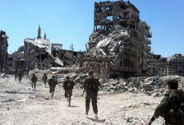 894189-syria-troops-homs