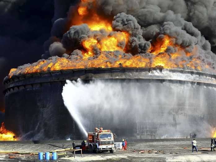 firefighters-work-to-put-out-the-fire-of-a-storage-oil-tank-at-the-port-of-es-sider-in-ras-lanuf-december-29-2014-reutersstringer