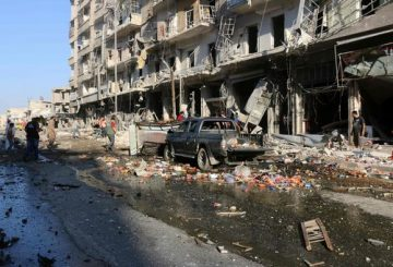 Syrians inspect the damage on a street following a reported airstrike at a market in the rebel-held district of Tariq al-Bab, in the northern city of Aleppo on July 1, 2016.  Separate air raids in northern Syria by regime aircraft and warplanes of the US-led international coalition killed at least 25 civilians, a monitoring group said. President Bashar al-Assad's air force attacked a crowded market in Aleppo city's rebel-held district of Tariq al-Bab, killing 11 people, the Syrian Observatory for Human Rights reported.   / AFP PHOTO / THAER MOHAMMED