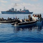 Royal Marines raiding craft from Fleet Contingency Troop (FCT), Fleet Protection Group Royal Marines (FPGRM) boarding and searching a Somalian Pirate Vessel.  RFA Fort Victoria is pictured in the background.  The Pirates were later taken onboard RFA Fort Victoria for repatriation and the vessel was destroyed.