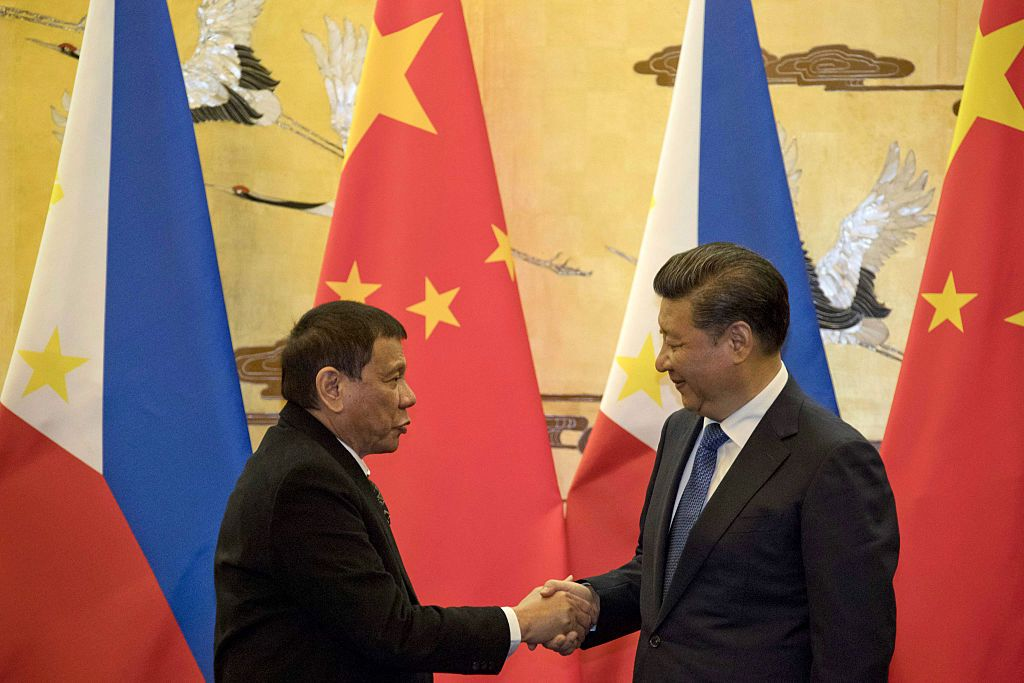 Philippines' President Rodrigo Duterte (L) and his Chinese counterpart Xi Jinping shake hands after a signing ceremony in Beijing on October 20, 2016.  Duterte met with his Chinese counterpart Xi on October 20, state media said, as the Philippines leader seeks closer ties with the Asian giant while blasting his US allies. / AFP / POOL        (Photo credit should read /AFP/Getty Images)