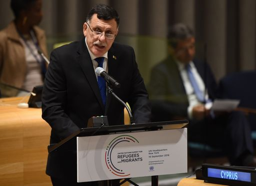 Fayez Mustafa al-Sarraj, Chairman of the Presidential Council of Libya and prime minister of the Government of National Accord of Libya, speaks during the High-level plenary meeting on addressing large movements of refugees and migrants in the Trusteeship Council Chamber during the 71st session of the United Nations in New York September 19, 2016. A summit to address the biggest refugee crisis since World War II opens at the United Nations on Monday, overshadowed by the ongoing war in Syria and faltering US-Russian efforts to halt the fighting. World leaders will adopt a political declaration at the first-ever summit on refugees and migrants that human rights groups have already dismissed as falling short of the needed international response.  / AFP PHOTO / TIMOTHY A. CLARY