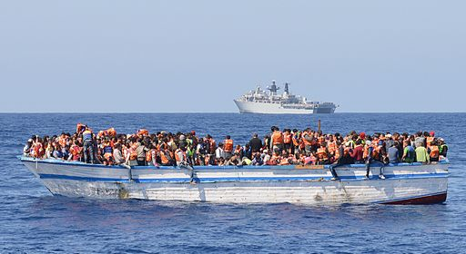 "In a handout picture released by the British Ministry of Defence (MOD) via their Defence News Imagery website on May 28, 2015 hundreds of migrants in a wooden-hulled ship are seen wearing lifejackets provided by Royal Navy personnel from British Royal Navy Albion-class assault ship HMS Bulwark (background) during a rescue mission in the Mediterranean Sea just north of the coast of Libya on May 28, 2015. Royal Navy personnel from HMS Bulwark were involved in an international rescue of hundreds of migrants from their stricken craft in the Central Mediterranean. 369 migrants crammed into a heavily overcrowded boat just north of Libya were led to safety from their stricken boat to landing craft from HMS Bulwark that have been converted into rescue boats loaded with lifejackets, medical facilities and emergency supplies. RESTRICTED TO EDITORIAL USE - MANDATORY CREDIT  "" AFP PHOTO / ROYAL NAVY / MOD / CROWN COPYRIGHT 2015 / ET WE(CIS) LOUISE GEORGE ""  -  NO MARKETING NO ADVERTISING CAMPAIGNS   -   DISTRIBUTED AS A SERVICE TO CLIENTS  -  NO ARCHIVE - TO BE USED WITHIN 2 DAYS (48 HOURS) FROM MAY 28, 2015, EXCEPT FOR MAGAZINES WHICH CAN PRINT THE PICTURE WHEN FIRST REPORTING ON THE EVENT"