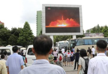 people are looking at the news that the second test-fire of ICBM Hwasong-14 was successfully carried out at night of July 28, Juche 106 (2017) under the supervision of Kim Jong Un, chairman of the Workers' Party of Korea, chairman of the State Affairs Commission of the DPRK and supreme commander of the Korean People's Army, at the Pyongyang railway station, in Pyongyang, DPRK, on Saturday, July 29th. (AP Photo/Jon Chol Jin)