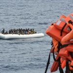 "(FILES) This file photo taken on November 05, 2016 shows migrants and refugees on a rubber boat waiting to be evacuated during a rescue operation by the crew of the Topaz Responder, a rescue ship run by Maltese NGO ""Moas"" and the Red Cross, on November 5, 2016 off the coast of Libya. Italian Foreign Minister Angelino Alfano on April 29, 2017 said he ""agreed 100 percent"" with a prosecutor Carmelo Zuccaro who has repeatedly suggested charity boats rescuing migrants in the Mediterranean are colluding with traffickers in Libya. / AFP PHOTO / ANDREAS SOLARO"