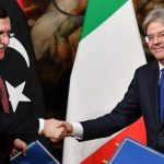 Italian Prime Minister Paolo Gentiloni (R) and Prime Minister of Libya Fayez al-Sarraj (Fayez al-Serraj) sign an agreement on Immigration at Chigi palace in Rome, Italy, 02 February 2017. ANSA/ETTORE FERRARI