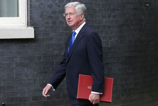 Britain's Defence Secretary Michael Fallon arrives to attend a Cabinet meeting at 10 Downing Street in central London on June 12, 2017, following the June 8 snap general election in which the ruling Conservatives lost their majority. Britain's embattled Prime Minister Theresa May on Sunday unveiled her full cabinet, making few changes as the premier clings to power after losing her parliamentary majority in a snap election. / AFP PHOTO / Daniel LEAL-OLIVAS
