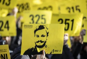 People hold signs depicting Giulio Regeni and reading ''365 days without Giulio'' as they attend a march in memory of the Italian researcher at Sapienza University on the first anniversary of his disappearance in Egypt, Rome, Italy, 25 January 2017. Italian President Sergio Mattarella on the same day called for cooperation to bring the killers of Regeni in Egypt to justice. 'Italy has mourned the killing of one of its studious young people, Giulio Regeni, without full light being shed on this tragic case for a year, despite the intense efforts of our judiciary and our diplomacy', Mattarella said on the first anniversary of Regeni's disappearance. 'We call for broader and more effective cooperation so that the culprits are brought to justice'. Guilio Regeni was an Italian PhD student researching the independent trade unions in Egypt, he disappeared on 25 January 2016 in Cairo, then his body was found in a ditch on Cairo-Alexandria road outside of Cairo on 03 February 2016 with signs of torture. ANSA/MASSIMO PERCOSSI
