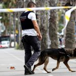 epa06151037 Catalonian Police Mossos D'Esquadra officer inspects with a dog the surrounding area of a hospital in Barcelona, Spain, 19 August 2017. At least 14 people have died and 130 were injured when two vehicles crashed into pedestrians in Las Ramblas, downtown Barcelona and on a promenade in Cambrils on 17 August. Spanish police is treating these incidents as terror attacks.  EPA/SERGIO BARRENECHEA