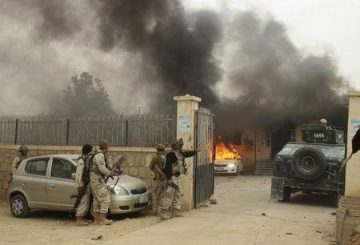 Afghan security forces arrive at the site of an attack in Kunduz province October 27, 2014. REUTERS/Stringer
