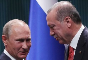 "Turkish President Recep Tayyip Erdogan (R) and Russian President Vladimir Putin (L) shake hands after a joint press conference following their meeting at the Presidential Complex in Ankara on September 28, 2017. The Russian President and his Turkish counterpart on September 28 agreed to push for the creation of a ""de-escalation"" zone in Syria's key northern province of Idlib to help end the civil war. / AFP PHOTO / ADEM ALTAN"