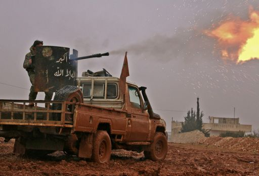 Syrian opposition fighters fire towards positions held by Islamic State (IS) group jihadists in al-Bab on the northeastern outskirts of the northern embattled city of Aleppo on December 13, 2016.  / AFP PHOTO / Saleh ABO GHALOUN