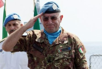 UNIFIL Force Commander Major General Claudio Graziano salutes during a handover ceremony on board an Italian naval ship September 1, 2008. French Rear Admiral Alain Hinden took the command of UNIFIL's Maritime Task Force from outgoing Italian commander Rear Admiral Ruggiero Di Biase during a ceremony today attended by UNIFIL Force Commander Major General Claudio Graziano. REUTERS/Ramzi Haidar/Pool (LEBANON)