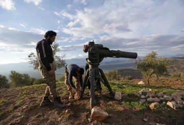 Turkish-backed Free Syrian Army fighters prepare a TOW anti-tank missile north of the city of Afrin, Syria February 18, 2018. REUTERS/Khalil Ashawi