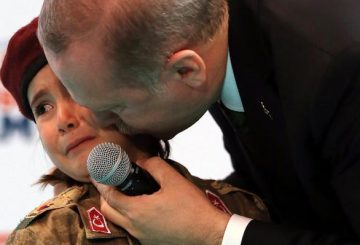 epa06561840 A handout photo made available by the Turkish Presidential Press Office shows Turkish President Recep Tayyip Erdogan (R) kissing a girl dressed as a Turkish soldier during the 6th ordinary provincial congress of the Justice and Development Party (AKP) in Kahramanmaras, Turkey, 24 February 2018. EPA/TURKISH PRESIDENTAL PRESS OFFICE / HANDOUT HANDOUT EDITORIAL USE ONLY/NO SALES