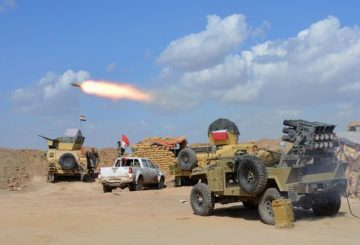 TOPSHOTS Iraqi government forces and allied militias fire weaponry from a position in the northern part of Diyala province, bordering Salaheddin province, as they take part in an assault to retake the city of Tikrit from jihadists of the Islamic State (IS) group, on March 2, 2015. Some 30,000 Iraqi troops and militia backed by aircraft pounded jihadists in and around Tikrit in the biggest offensive yet to retake one of the Islamic State group's main strongholds. Iraqi forces tried and failed several times to wrest back Tikrit, a Sunni Arab city on the Tigris river about 160 kilometres (100 miles) north of Baghdad. AFP PHOTO / YOUNIS AL-BAYATI
