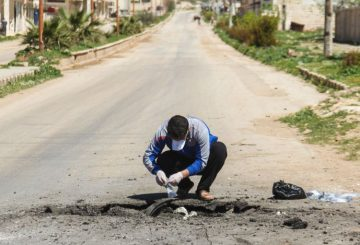 A Syrian man collects samples from the site of a suspected toxic gas attack in Khan Sheikhun, in Syrias northwestern Idlib province, on April 5, 2017. International outrage is mounting over a suspected chemical attack that killed scores of civilians in Khan Sheikhun on April 4, 2017. / AFP PHOTO / Omar haj kadour (Photo credit should read OMAR HAJ KADOUR/AFP/Getty Images)