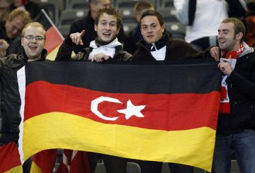 Soccer fans pose before the Euro 2012 qualifying soccer match between Turkey and Germany at the Olympic stadium in Berlin October 8, 2010. REUTERS/Thomas Peter (GERMANY - Tags: SPORT SOCCER)