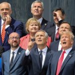 (First row L-R) German Chancellor Angela Merkel, Belgium's Prime Minister Charles Michel, NATO Secretary General Jens Stoltenberg, US President Donald Trump, Britain's Prime Minister Theresa May (second row L-R) Denmark's Prime Minister Lars Lokke Rasmussen, Norway's Prime Minister Erna Solberg, Poland's President Andrzej Duda, French President Emmanuel Macron (third row) Albania's Prime Minister Edi Rama, Czech Republic President Milos Zeman and Spain's Prime Minister Pedro Sanchez pose for a family picture ahead of the opening ceremony of the NATO (North Atlantic Treaty Organization) summit, at the NATO headquarters in Brussels, Belgium July 11, 2018. Ludovic Marin/Pool via REUTERS     TPX IMAGES OF THE DAY - RC1399E0AA40
