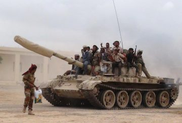 Southern People's Resistance militants loyal to Yemen's President Abd-Rabbu Mansour Hadi move a tank from the al-Anad air base in the country's southern province of Lahej, March 24, 2015. Fighters from Yemen's dominant Houthi movement drew closer to President Abd-Rabbu Mansour Hadi's refuge in Aden on Tuesday, taking over two towns north of the port city as columns advanced from different directions. REUTERS/Stringer