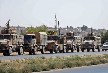 "Turkish forces are seen in a convoy on a main highway between Damascus and Aleppo, near the town of Saraqib in Syria's northern Idlib province, on August 29, 2018. - Russian Foreign Minister Sergei Lavrov said in a press conference today that there is ""full political understanding"" between Russia and Turkey, who support opposing sides of the Syrian civil war but are currently in intense negotiations to ensure Idlib does not become a breaking point in their alliance. (Photo by OMAR HAJ KADOUR / AFP) (Photo credit should read OMAR HAJ KADOUR/AFP/Getty Images)"