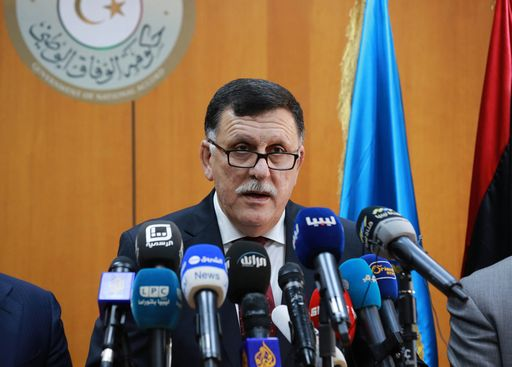 Libya's UN-backed Prime Minister-designate, Fayez al-Sarraj, flanked by members of the presidential council, speaks during a press conference on March 30, 2016 in the capital Tripoli.  Fayez al-Sarraj arrived in Tripoli following months of mounting international pressure for the country's warring sides to allow him to start work. / AFP PHOTO / STRINGER