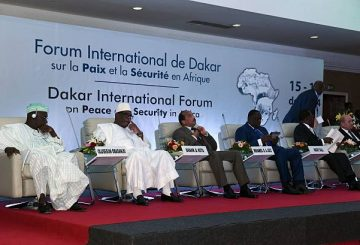 The presidium of International Forum on Peace and Security in Africa is seen in Dakar on December 16, 2014. AFP PHOTO / SEYLLOU (Photo credit should read SEYLLOU/AFP/Getty Images)
