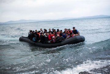 TOPSHOTS A dinghy overcrowded with Afghan immigrants arrived on a beach on the Greek island of Kos, after crossing a part of the Aegean Sea between Turkey and Greece, on May 27, 2015. AFP PHOTO / Angelos Tzortzinis