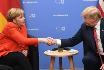 Germanyís Chancellor Angela Merkel (L) and US President Donald Trump shake hands during a bilateral meeting, on the sidelines of the G20 Leaders' Summit in Buenos Aires, on December 01, 2018. - The leaders of countries representing four-fifths of the global economy opened a two-day meeting in Argentina facing the deepest fractures since the first G20 summit convened 10 years ago in the throes of financial crisis. (Photo by SAUL LOEB / AFP)