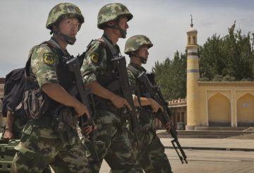 KASHGAR, CHINA - JULY 31: Chinese soldiers march in front of the Id Kah Mosque, China's largest, on July 31, 2014 in Kashgar, China. China has increased security in many parts of the restive Xinjiang province following some of the worst violence in months in the Uyghur dominated area. (Photo by Getty Images)