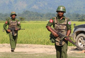 In this photograph taken on October 21, 2016, armed Myanmar army soldiers patrol a village in Maungdaw located in Rakhine State as security operation continue following the October 9, 2016 attacks by armed militant Muslim. - The United Nations called for an investigation into claims Myanmar troops have been killing civilians and torching villages in northern Rakhine, as reports emerged thousands of Rohingya had been forced from their homes. (Photo by STR / AFP)