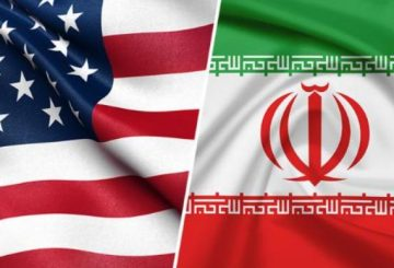 180606093823-us-iran-flags-live-video