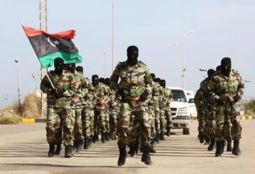 epa04486669 Libyan Army soldiers parade during a graduation ceremony of the first batch of the Tripoli air base security and protection batallion of the Presidency of the General Staff of the Libyan army, in Tripoli, Libya, 12 November 2014. EPA/STR