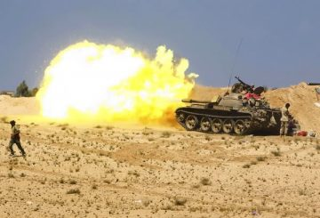 [Anti-Gaddafi fighters fire from tanks during clashes with pro-Gaddafi forces near Sirte, September 28, 2011. Sirte, one of the last bastions of support for Muammar Gaddafi, is encircled by forces of Libya's ruling National Transitional Council (NTC) and under bombardment from NATO warplanes. REUTERS/Asmaa Waguih (LIBYA - Tags: POLITICS CIVIL UNREST CONFLICT TPX IMAGES OF THE DAY)] *** []