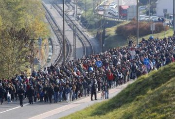 epa07207861 (FILE) - Migrants are escorted by Slovenian police officers toward the Slovenian-Austrian border crossing in Sentilj, Slovenia, 31 October 2015 (reissued 04 December 2018). Merkel defended her decision to take in thousands of refugees who were stuck in Hungary coming through the Balkan Route with the words 'We can manage' which earned her both respect for the humanitarian decision and criticism for ceasing the so-called Dublin Rules. A successor to Angela Merkel as chairwoman of her CDU party will be elected on 07 December 2018. Merkel said she will not run for re-election as CDU chairwoman nor for Chancellor nor for any other political office. EPA/GYORGY VARGA HUNGARY OUT ATTENTION: This Image is part of a PHOTO SET