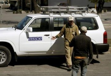 municipal-workers-take-photo-organization-security-cooperation-europe-osce-car-near-seized
