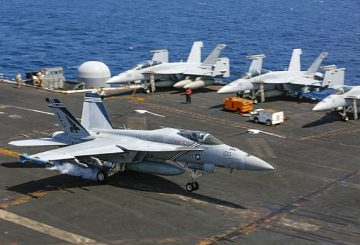 190921-N-PW030-1300 ARABIAN SEA (Sept. 21, 2019) An F/A-18E Super Hornet attached to the Pukin' Dogs of Strike Fighter Squadron (VFA) 143 makes an arrested landing on the flight deck of the aircraft carrier USS Abraham Lincoln (CVN 72). The Abraham Lincoln Carrier Strike Group is deployed to the U.S. 5th Fleet area of operations in support of naval operations to ensure maritime stability and security in the Central Region, connecting the Mediterranean and the Pacific through the western Indian Ocean and three strategic choke points. With Abraham Lincoln as the flagship, deployed strike group assets include staffs, ships and aircraft of Carrier Strike Group (CSG) 12, Destroyer Squadron (DESRON) 2, the guided-missile cruiser USS Leyte Gulf (CG 55) and Carrier Air Wing (CVW) 7.  (U.S. Navy photo by Mass Communication Specialist 3rd Class Tristan Kyle Labuguen/Released)