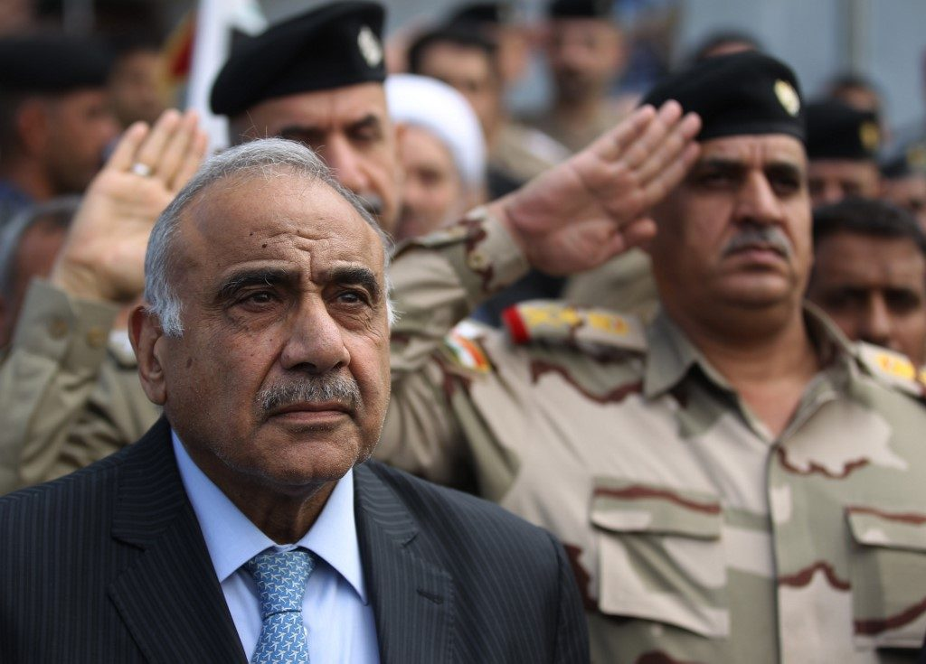 (FILES) In this file photo taken on October 23, 2019 Iraq's Prime Minister Adel Abdel Mahdi speaks during a funeral ceremony in Baghdad. - Iraq's embattled premier announced yesterday he would resign in keeping with the wishes of the country's top cleric, as renewed violence added to a soaring death toll in two months of anti-government protests. (Photo by AHMAD AL-RUBAYE / AFP)