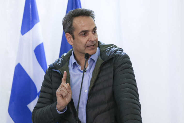 Greek Prime Minister Kyriakos Mitsotakis gestures during joint press statements with European Commission President Ursula von der Leyen and European Council President Charles Michel, in Kastanies at the Greek-Turkish border on Tuesday, March 3, 2020. Migrants and refugees hoping to enter Greece from Turkey appeared to be fanning out across a broader swathe of the roughly 200-kilometer-long land border Tuesday, maintaining pressure on the frontier after Ankara declared its borders with the European Union open.(AP Photo/Giannis Papanikos)