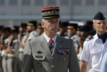 New armed forces chief of staff Gen. Francois Lecointre reviews the troops at the Istres air base, southern France, Thursday, July 20, 2017. (AP Photo/Claude Paris)