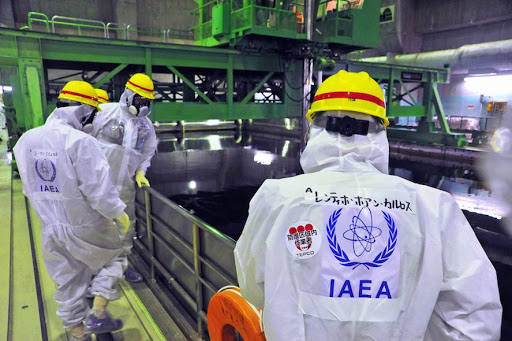 "This handout picture taken by the International Atomic Energy Agency (IAEA) on November 27, 2013 shows review mission members of the IAEA inspecting the crippled Tokyo Electric Power CO. (TEPCO) Fukushima Dai-ichi nuclear power plant in the town of Okuma in Fukushima prefecture. The UN's nuclear watchdog on November 25 kicked off a review of Japan's efforts to shut down the disaster-hit Fukushima plant after its operator began removing nuclear fuel.      AFP PHOTO / IAEA ---EDITORS NOTE---HANDOUT RESTRICTED TO EDITORIAL USE - MANDATORY CREDIT ""AFP PHOTO / IAEA"" - NO MARKETING NO ADVERTISING CAMPAIGNS - DISTRIBUTED AS A SERVICE TO CLIENTS"