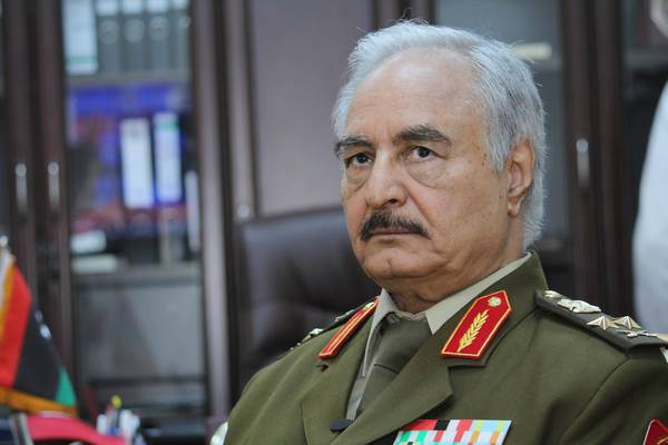 FILE - In this March 18, 2015 file photo, Gen. Khalifa Hifter, then Libyas top army chief, speaks during an interview with the Associated Press in al-Marj, Libya. From east and west, the forces of Libyas rival powers are each moving on the city of Sirte, vowing to free it from the hold of the Islamic State group. Hitter, backed by Egypt and the United Arab Emirates, he is considered a hero in the east. But he is widely despised in western Libya, where his opponents depict him as a would-be dictator along the lines of Gahdafi. (ANSA/AP Photo/Mohammed El-Sheikhy, File) [CopyrightNotice: Copyright 2016 The Associated Press. All rights reserved. This material may not be published, broadcast, rewritten or redistribu]