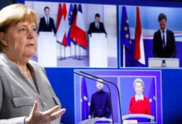 German Chancellor Angela Merkel attends a virtual news conference with Austrian Chancellor Sebastian Kurz, French president Emmanuel Macron, Netherlands Prime Minister Mark Rutte, European Commission President Ursula von der Leyen and European Council President Charles Michel, clockwise on the screen, at the chancellery in Berlin, Germany, Tuesday, Nov. 10, 2020. The news conference following on a virtual meeting about terrorism in Europe. (AP Photo/Markus Schreiber, pool)