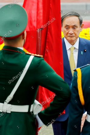 Mandatory Credit: Photo by Minh Hoang/AP/Shutterstock (10964461a) Japanese Prime Minister Yoshihide Suga, right, with his Vietnamese counterpart Nguyen Xuan Phuc, reviews an honor guard at the Presidential Palace in Hanoi, Vietnam, . Suga is on an official visit to Vietnam from Oct. 18 to 20, 2020 Japan, Hanoi, Vietnam - 19 Oct 2020