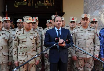 """A handout picture released by the Middle East News Agency (MENA) shows Egyptian President Abdel Fattah el-Sisi (C), surrounded by top military generals, as he addresses journalists following an emergency meeting of the Supreme Council of the armed Forces in Cairo on January 31, 2015. Sisi said the battle against jihadist insurgents in the Sinai Peninsula would be a long and hard one, as violence there continues unabated. AFP PHOTO / MENA / HO == RESTRICTED TO EDITORIAL USE - MANDATORY CREDIT """"AFP PHOTO / HO / MENA"""" - NO MARKETING NO ADVERTISING CAMPAIGNS - DISTRIBUTED AS A SERVICE TO CLIENTS == (Photo by MENA / MENA / AFP)"""