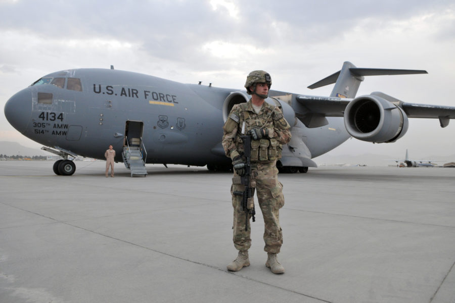Army Sergeant 1st Class Jon Waterhouse, deployed from the 127th Military Police Company, Fort Carson, Colo., provides security near a C-17 Globemaster from Joint Base McGuire-Dix-Lakehurst while the aircrew wait for Army Gen. Martin E. Dempsey, 18th Chairman of the Joint Chiefs of Staff, to return for the next leg of his trip from Kabul International Airport to another location in the region. During Dempsey's first visit to Regional Command-Capital in Kabul, Oct. 20, 2011, he met with Marine Gen. John R. Allen, commander of NATOÕs International Security Assistance Force in Afghanistan (ISAF), and U.S. Army Lt. Gen. Curtis Scaparrotti, ISAF Joint Command commander. Waterhouse is the personal security officer to COMISAF and is a native of Yucaipa, Calif. (U.S. Air Force photo/Master Sgt. Michael OÕConnor/Released)